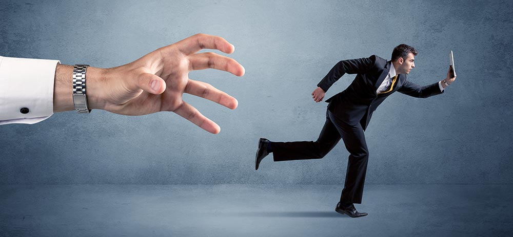 Avoid this Costly Hiring Mistake! Arm trying to catch business man.