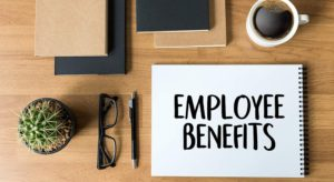 Paid Leave and Flexible Benefits aren't Just Perks (employee benefits notebook on desk)